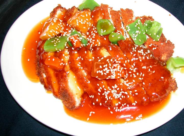Pittig gegrilde kip met zoetzure saus